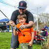 3rd grader Oscar Ronner-Bland gets help from his father Dan as he prepares to makes a cast at the 2019 37th Annual Hampton Fishing Derby sponsored by the Hampton Rec Department on Saturday 5-11-2018 @ Batchelder Pond, Hampton, NH.  Matt Parker Photos