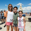 Michele Fremault of Westford MA has been coming to Hampton Beach for 19 years to see the sand castles with her daughters 8th grader Raegan and 5th grader Mia on a sunny-windy afternoon at the 19th Annual Mater Sand Sculpting Classic Competition on Saturday 6-22-2019 at Hampton Beach, NH.  [Matt Parker/Seacoastonline]