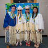(L to R) Mac Baker, Maggie Brown, Jenna Myers and Katherine Shek pose in their Hawaiian grass skirts at the Winnacunnet High School Class of 2019 Graduation Ceremony on June 7, 2019, 6:00 PM @ WHS, Hampton, NH.  [Matt Parker/Seacoastonline]