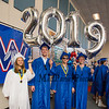 """(L to R) Brooke McErlain, Joseph MacDougall, Joshua Chase and Lou Grainger hold up """"2019"""" ballons while getting ready for the entrance march at the Winnacunnet High School Class of 2019 Graduation Ceremony on June 7, 2019, 6:00 PM @ WHS, Hampton, NH.  [Matt Parker/Seacoastonline]"""