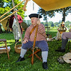 Billy Clemens of Danvers Mass with the Militia Encampment of Essex Country MA taking a break from the hot sun at the Annual 2019 American Independence Festival on Saturday 7-13-2019 @ Exeter, NH.  [Matt Parker/Seacoastonline]