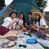 Dover residents (L to R) Talia Lumingkewas, Gabrielle Suleiman, Alex de Jesus and Patricia Louis having marshmellows with chocolate fondu prior to the start of the Annual Portsmouth Fireworks celebration on Wednesday 7-3-2019 @ Leary Field, Portsmouth, NH.  Matt Parker Photos