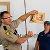 """N.H. Forest Ranger Michael Matson reads """"Smokey The Bear"""" by Jan Werner with pictures by Richard Scarry to the children and parents on Tuesday at Smokey's 75th birthday celebration at the Hampton Falls Fire Department on 7-9-2019 @ Hampton Falls, NH.  [Matt Parker/Seacoastonline]"""