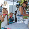 Amy Gunzelmann purchases Red Sox Raffle tickets while her kids1st grader Ellie and preschooler Eddy hold up what they hope are the winning tickets at the Lane Library Summer Reading Finale Party and Ice Cream Social on Thursday 8-8-2019 @ Tuck Field, Hampton NH.  Matt Parker Photos
