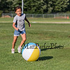 3rd grader Jayme Kelly of Hampton kicks a beach ball at the Lane Library Summer Reading Finale Party and Ice Cream Social on Thursday 8-8-2019 @ Tuck Field, Hampton NH.  Matt Parker Photos