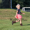 Preschooler Emily Kelly of Hampton runs across the lawn in her cowboy boots at the Lane Library Summer Reading Finale Party and Ice Cream Social on Thursday 8-8-2019 @ Tuck Field, Hampton NH.  Matt Parker Photos