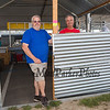 Members and volunteers of St. James Masonic Lodge of Hampton Nathan Page (L) and Jay Ring put the finishing touches on their food booth which the lodge has attended for the past 19 years, 30th Annual Hampton Beach Seafood Festival, setting up the food booths on Thursday 9-5-2019 @ Hampton Beach, NH.  Matt Parker Photos