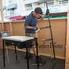 Plumber Sam Reid of Hart Plumbing and heating hooks up gas lines to a food booth at the 30th Annual Hampton Beach Seafood Festival, setting up the food booths on Thursday 9-5-2019 @ Hampton Beach, NH.  Matt Parker Photos