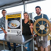 Employees of Sea Dog Brewing Company take a break from setting up their food booth (L to R) GM Don Perkins, Dining Room Mgr Alicia Benvenuti and head Chef Pat Armstrong, 30th Annual Hampton Beach Seafood Festival, setting up the food booths on Thursday 9-5-2019 @ Hampton Beach, NH.  Matt Parker Photos