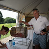 Fred Schaake putting in his raffle ticket, NH Legends of Hockey Annual Golf Classic held at Stonebridge Country Club on Friday July 16, 2021, Goffstown, NH.  Matt Parker Photos