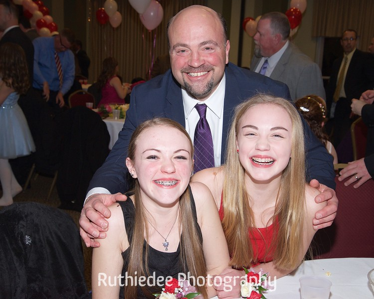 Dad with daughters.jpg