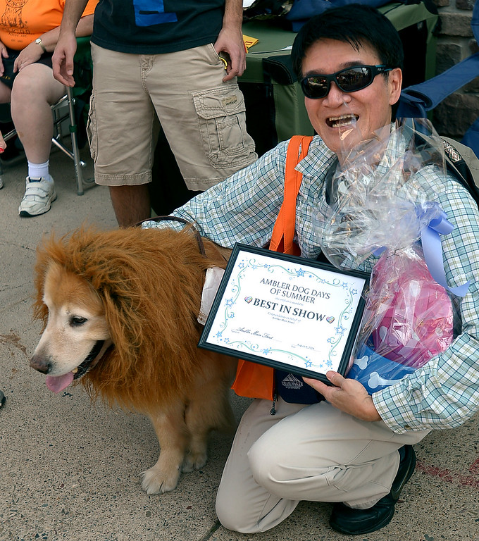 . Best of Show went to Ming Chan and his golden retriever, Art, a rescue dog from Taiwan at the Ambler Dog Days Parade Saturday, Aug. 9, 2014.  Montgomery Media staff photo by Bob Raines
