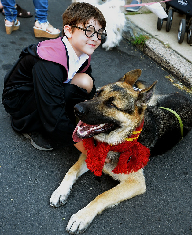 . Jack Rooney and his German shepherd, Gryffindor, won the Most Inventive Name category with their Harry Potter theme at the Ambler Dog Days Parade Saturday, Aug. 9, 2014.  Montgomery Media staff photo by Bob Raines