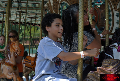 Val, Elijah, and Brazil Ride the Carousel