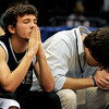 "Tanner's Zach Whitt, left, son of head coach Chris Whitt, prays for a miracle as the Rattlers were still trailing by one point with a few seconds left before the end of the state championship game at the BJCC in Birmingham on March 3, 2011. ""I was asking God to make us win, especially for my dad because he deserves this more than anyone else,"" Zach Whitt said after the game. His prayers were answered and Tanner High School won the state title again after 25 years."