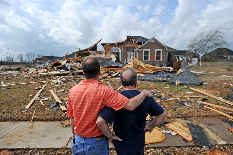 Jerry Vonderhaar, left, comforts Charles Kellogg after a tornado destroyed Kellogg's house in the Eagle Point subdivision of Limestone County, Ala. on Friday, March 2, 2012. Vonderhaar also offered his house for Kellogg and his wife to stay.