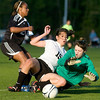 Austin goalkeeper Morgan Hampton, right, makes a big save against Decatur's Mariah Mort (15) during the game in the third day of Morgan County Tournament Thursday, April 8, 2010.