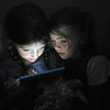 "Eliza Balch, left, and Delaney Emmons play an electronic game backstage during the dress rehearsal of the musical ""Annie Jr."" at Hartselle Fine Arts Center Tuesday, July 26, 2011."