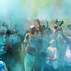 "Participants in the ""Color Your World"" 5K run at Oakville Indian Mounds Park cheer in a cloud of colored powder at the end of the run Saturday, June 8, 2013. The event, organized by Mount View Baptist Church, raised funds for an International Mission Team to go to Nicaragua."