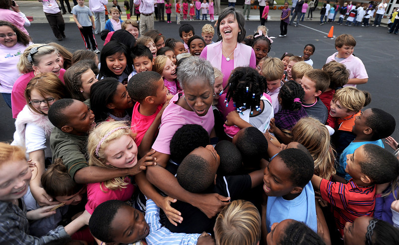 Chestnut Grove Elementary School students and teachers released about 500 pink balloons in honor of the school's principal, Lauretta Teague, and music teacher Robin Barker, both of whom are breast cancer survivors, Thursday, October 27, 2011. Students rush to hug Teague and Barker after they released the balloons. The celebration was a surprise for both of them.
