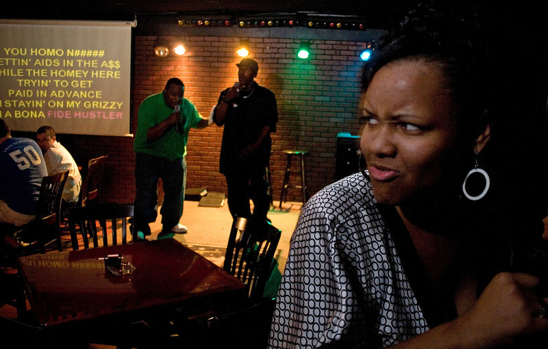 Kris Martin, foreground, dances to the song performed by two hip-hop aficionados at the Starz Karaoke Lounge in Birmingham Saturday, March 22, 2008.