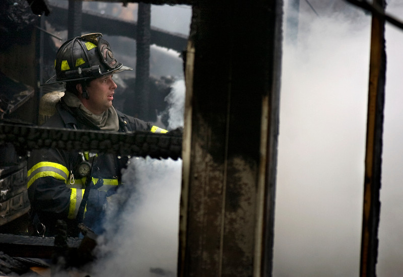 A Decatur firefighter battles a Fire in a furniture store on Austinville Flint Road Saturday, April 18, 2009.