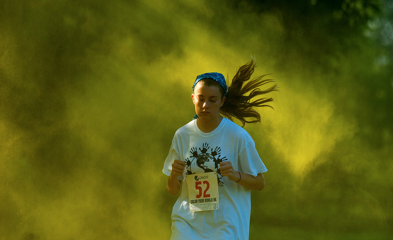 "Katelee Witt competes in the ""Color Your World"" 5K run at Oakville Indian Mounds Park Saturday, June 8, 2013."