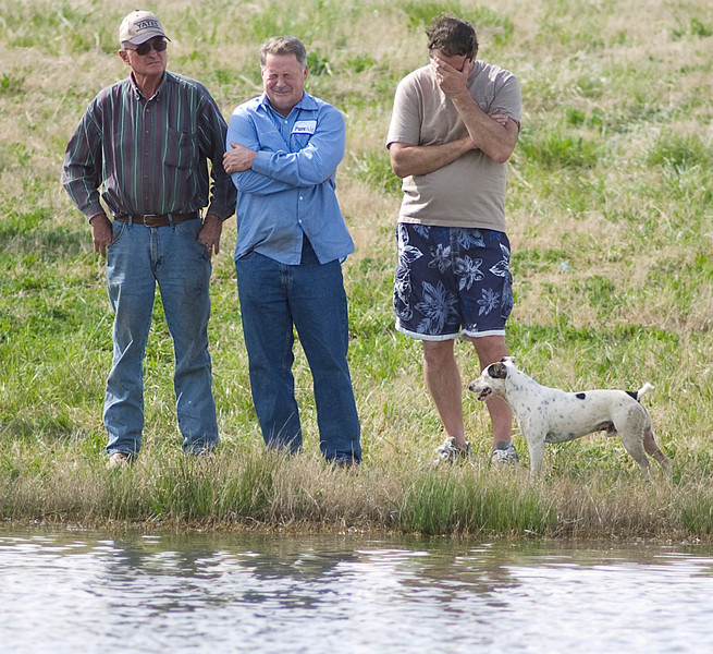 Randall Willingham, center, cries while divers search for his son, John Arlon Willingham, in a pond on Johnson Rd. Friday, April 2, 2010. John Willingham's body was found shortly before 5 p.m.