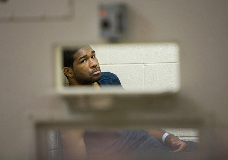 A man arrested for burglary awaits his food in a cell at the Morgan County Jail Monday, May 17, 2010.