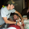 Keith Barber moans in pain as his son, Joey, and his mother, Faye Barber, loosen the bandages on his left arm Monday, July 6, 2009. Barber, 49, has been paralyzed and unable to talk since a traffic accident almost two years ago.