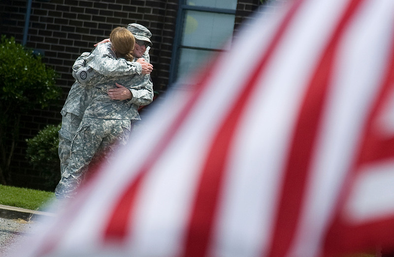 Sgt. Sean Cave, from Grant, and Sgt. Denise Spiller, from Madison, hug before going home after the welcome ceremony at the Army National Guard Armory in Athens Saturday, June 19, 2010. They spent one year with the same military police unit in Iraq.