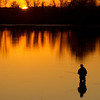 As the sun sets, Nick Meadows fishes in the waters of the Wheeler National Wildlife Refuge in Decatur, Ala. Thursday, January 5, 2012.