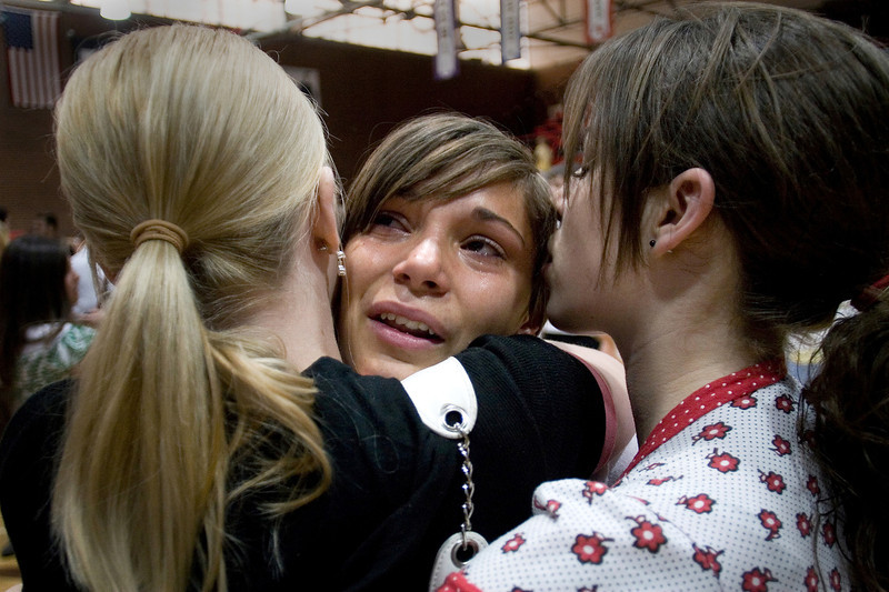 Leah Jones, left, and Nicole Ashby, right, console Hannah Walker after the counseling service for Trevis Landeen's death at American Fork High School, Tuesday, June 26, 2007. Hannah Walker was the student body vice president and worked closely with Landeen, who was the president.
