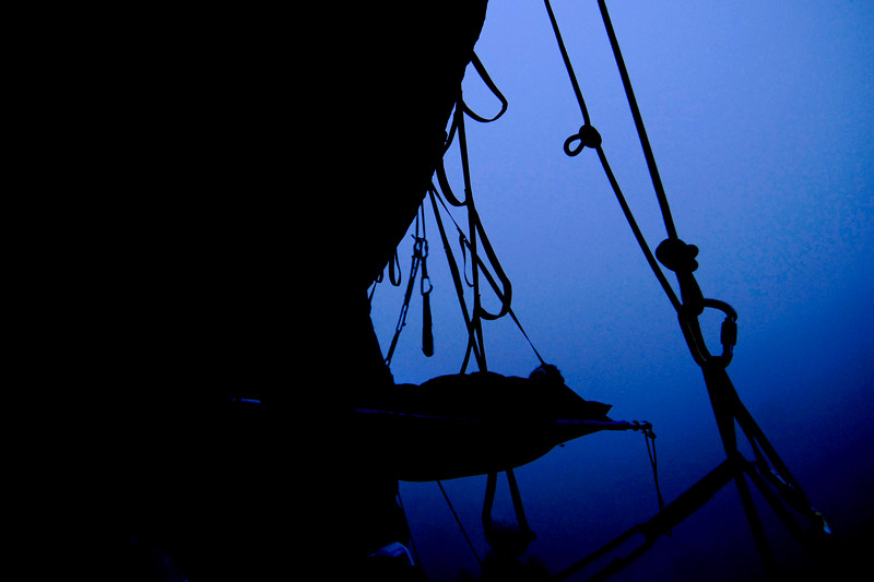 "Dawn begins to break after a night in the portaledge (David Hoffberg at ""the Foot"")"
