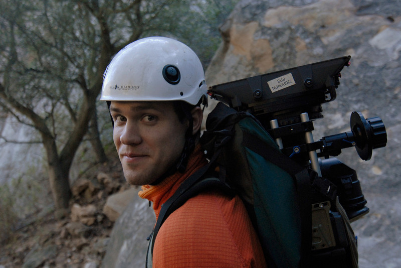 Earthworks guide Jesse Groves shoulders a 50-pound HD video camera and prepares to climb with the camera into position for the filming  of a television pilot.
