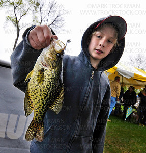 Nathan Keller, 12, shows off the .67-pound crappie he caught in Spring Park Bay Saturday, April 21.  Keller, Golden Valley, was in the running for heaviest crappie in the 14-and-under class of the 2012 Lions Club Crappie Fishing Contest.  The official weigh-in was held outside Maynard's restaurant on the shore of Excelsior Bay.