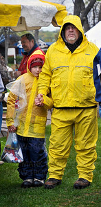 Rob, right, and Trace Eddington stand in the rain near the weigh-in tent at Maynard's restaurant in Excelsior after catching 20 crappies during the Lions Club Crappie Fishing Contest held Saturday, April 2, on Lake Minnetonka.