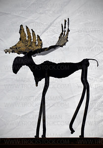 A hand-made steel and bronze moose is silhouetted against the back of local artist Buzz Leighton's tented booth at Art on The Lake on the Commons in Excelsior Saturday, June 11, 2011.  The two-day art festival is held in Excelsior's 14-acre community park, Excelsior Commons, located on the south shores of Lake Minnetonka.