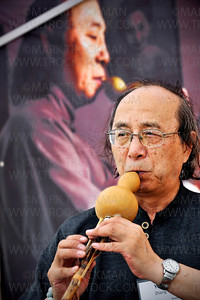 Chinese composer, conductor and woodwind soloist Ying Zhang played a tune with a Hulusi, or gourd flute, in his tent at Art on the Lake Saturday, June 11, on Excelsior Commons.  Zhang was selling several different types of natural and handmade woodwind instruments.