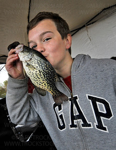 10 year old Mound resident Jack Dioszeghy kisses his .76-pound crappie in the weigh-in tent at Maynard's restaurant in Excelsior during the 2012 Lions Club Lake Minnetonka Crappie Fishing Contest Saturday, April 21, 2012.  Dioszeghy's catch was the heaviest fish, at the time of his weigh-in, for the 14-and-under class competition.  The kids winner was Brandon Ballinger with a .95-pound crappie.