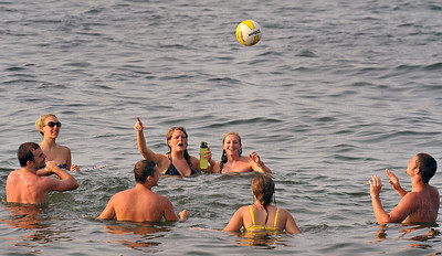 The hot and humid mid-summer weather was quenched by these friends bopping a volleyball around in Excelsior Bay during the annual 4th of July celebration at The Commons last Tuesday evening.