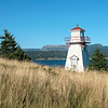 Woody Point Lighthouse at coast, Southeast Brook Falls, Gros Morne National Park, Newfoundland and Labrador, Canada