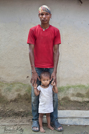 "CONCERNED FATHERHOOD  ""I married early and never went to school. I want my son to go to school.""   Dhangadi, Nepal."