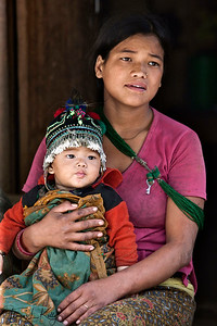 "QUESTION   ""Life is difficult. How will I educate my son?""  Rolpa, Nepal."