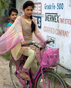 """BICYCLE RIDE  Watch out for bumps! Shakti on wheels.  """"I love my bicycle!""""  Dhangadi, Nepal."""
