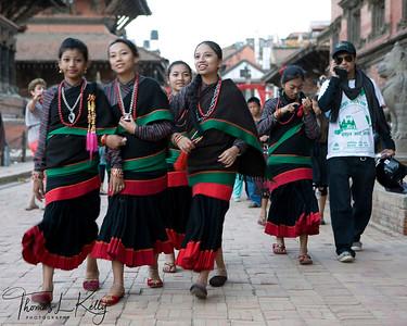 "NEWAR GIRLS  Newar Girls, the original inhabitants of the Kathmandu valley, wear Hakku Pattasi, the Newar attire in Patan Durbar Square. ""We don't question tradition.""   Bhaktapur, Nepal."