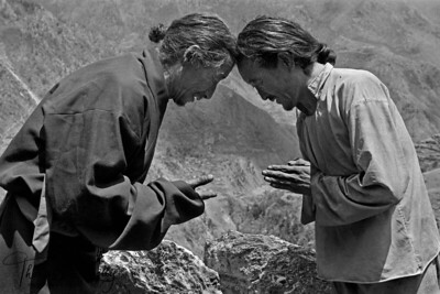 "Tibetan greeting and farewell: exchanging energies with  the touch of the head, master, with open hands, receives his disciple, who holds his hands in a gesture of offering.  Humla. Nepal  Museo Silver Rag (B & W Digital Print) Dimesion: 12.887"" x 20"" US$600 Edition 1/25"