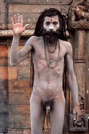 NAGA BABA This ash-covered sadhu holds up his right hand in what is known in sanskrit as an abhaya mudra  meaning, having no fear belongs to the Naga sub-sect of sadhus, famed for going naked no matter the weather and for possessing a warrior-like mentality. The great Hindu saint and reformer Adi Shankaracharya founded such warrior sub-sects, called akhadas, in order to provide protection for the scholarly sub-sects of sadhus during medieval times. Pashupatinath, Kathmandu, Nepal.