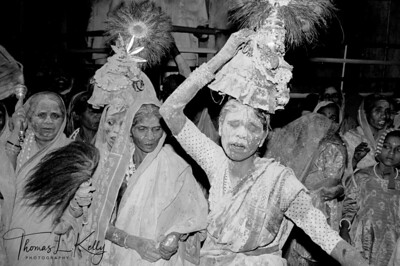 YELLAMA DEVADASI  Weaving in trance, drenched in sacred healing turmeric, devadasis 'handmaidens of the Goddess' sway through the crowds, with images of goddess Yellama balanced on their heads, a renewal of the life force at her yearly festival.  Auspicious but impure, according to Medieval temple records, devadasis brought critical income to the temples. Clients made offerings for physical union with the Goddess in the form of devadasis. Today, Yellama's devotees are mostly bonded laborers who till the soil for landlords, and many devadasis find themselves in Mumbai red light districts. HIV and STD run rampant in these communities.  Saundatti, Karnataka, India.