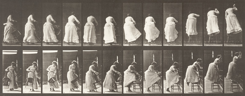 Draped woman stepping on a chair and reaching up (Animal Locomotion, 1887, plate 457)